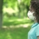 Girl In Respirator Give Flowers. - VideoHive Item for Sale