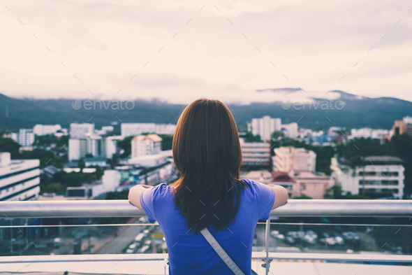 Hipster young girl looking the city on observation deck - Stock Photo - Images