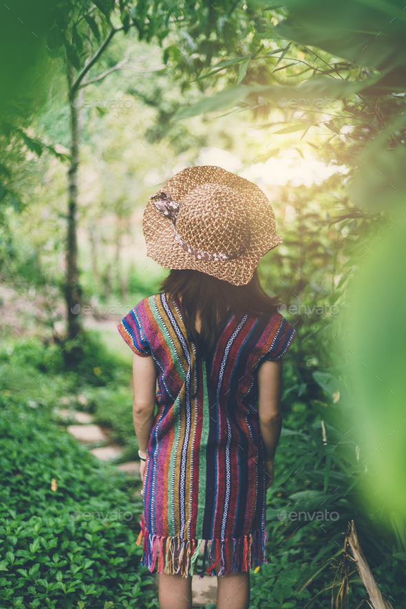 Young women walking alone in the garden - Stock Photo - Images