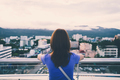 Hipster young girl looking the city on observation deck - PhotoDune Item for Sale
