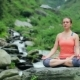 Woman Meditating at Tropical Waterfall in Lotus Pose Padmasana - VideoHive Item for Sale