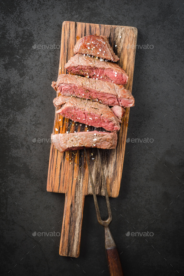 Steak on wooden board - Stock Photo - Images