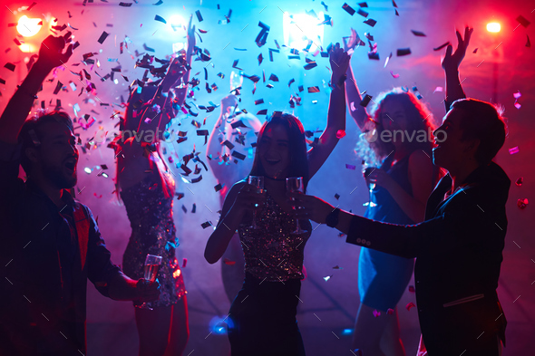 Toasting at disco - Stock Photo - Images