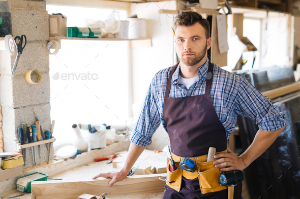 Carpenter in workshop - Stock Photo - Images
