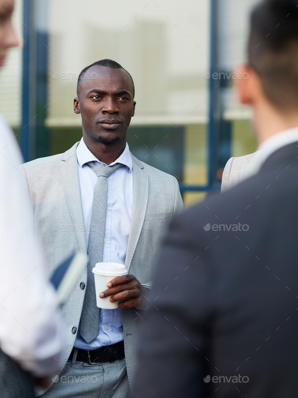 Interacting at coffee break - Stock Photo - Images