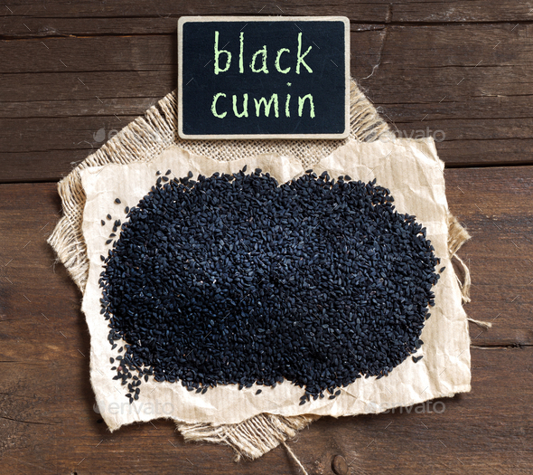 Nigella sativa or Black cumin with small chalkboard - Stock Photo - Images