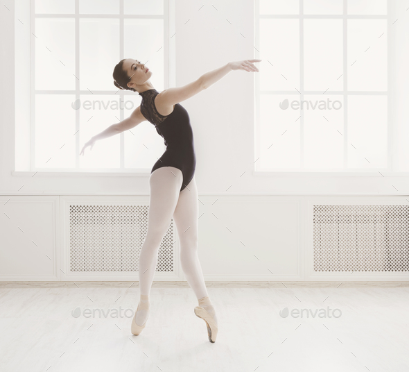 Beautiful ballerine stands in ballet position