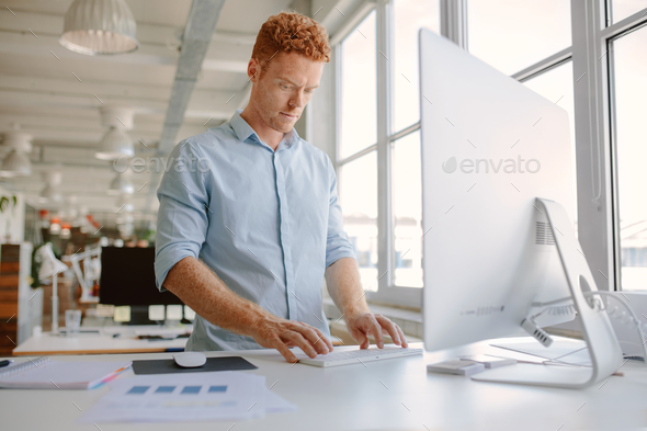 Businessman working in modern office - Stock Photo - Images