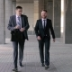 Two Young Businessmen Walking To The Office Together - VideoHive Item for Sale