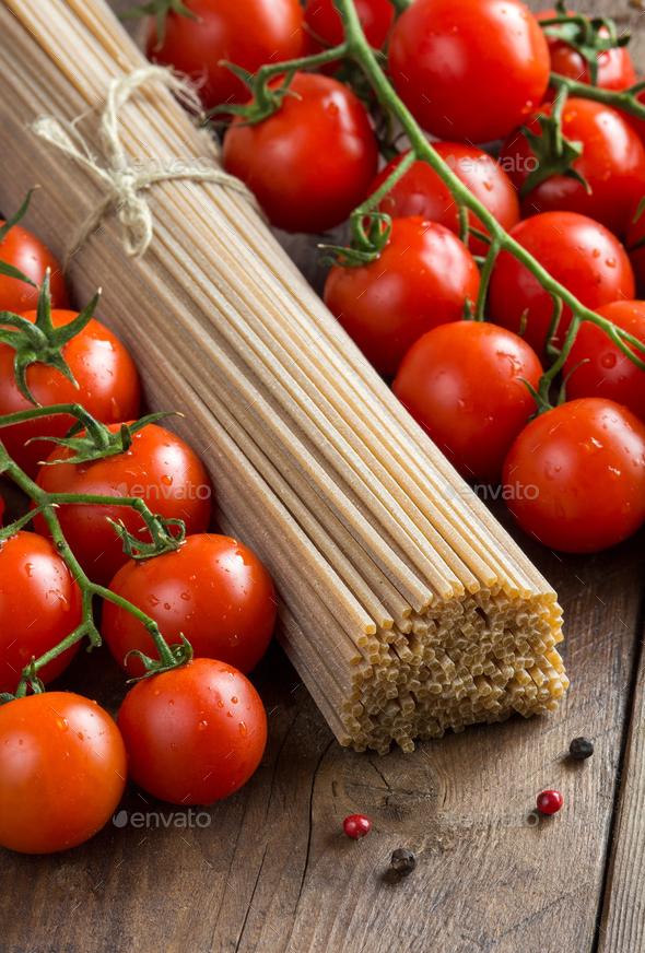 Whole wheat spaghetti and tomatoes - Stock Photo - Images