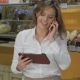 Woman Talks On The Phone At The Pastry Shop - VideoHive Item for Sale