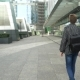 Man With a Leather Backpack Walking Through The City - VideoHive Item for Sale