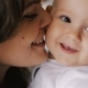 Young Happy Mother Holding Her Newborn Child And Kissing. Family At Home. Beautiful Smiling - VideoHive Item for Sale