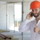 Construction Engineer Talking On The Phone At The Building Under Construction - VideoHive Item for Sale