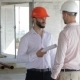 Architector and Builder Shake Hands at the Building under Construction - VideoHive Item for Sale