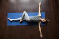 Yoga at home: Jathara Parivartanasana Pose - PhotoDune Item for Sale