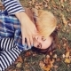 Young Mother And Her Baby Fall Fun In The Autumn Leaves In . Blurred Pram On The Background - VideoHive Item for Sale