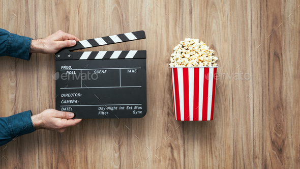 Director holding a clapper board - Stock Photo - Images