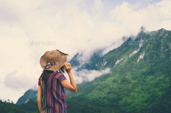 Woman traveler looking fog on the mountain - Stock Photo - Images