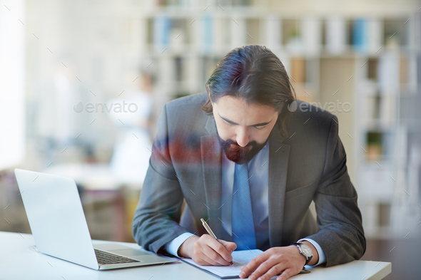 Businessman busy at work - Stock Photo - Images