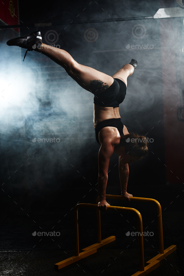 Keeping balance on bars - Stock Photo - Images