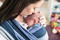 Unrecognizable young mother with her son in sling - PhotoDune Item for Sale