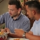 Two Men Eating a Pitta In The Indian Restaurant - VideoHive Item for Sale