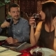 Man And Woman Talking With Friends In Restaurant - VideoHive Item for Sale