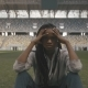 Nervous Sporty African-american Woman Sitting Alone In The Middle Og Sports Stadium And Looking To - VideoHive Item for Sale