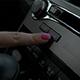 Car Interior Female Hand Typing Media Button