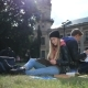Young Student Couple Studying In The Park Lawn - VideoHive Item for Sale