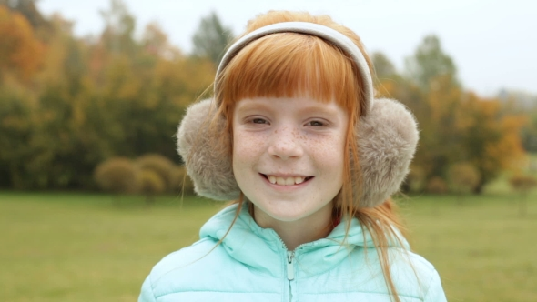 ginger girl in the earmuffs winkingzdyma4 | videohive