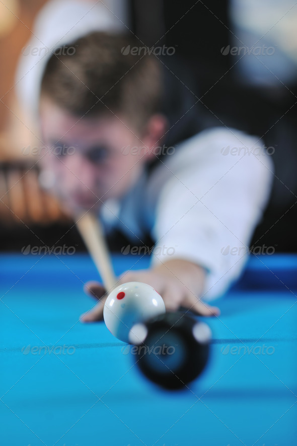 young man play pro billiard game - Stock Photo - Images