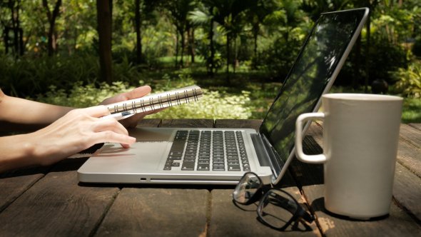 use laptop and writing notes by nuwanhaha videohive