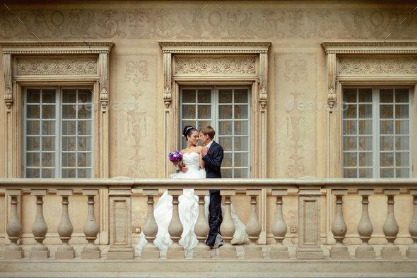 Wedding couple indoors is hugging each other - Stock Photo - Images