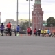 Unrecognizable Marathon Runners And Cyclists Against Moscow Kremlin.  Background Bokeh Long Shot - VideoHive Item for Sale