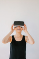 Young woman using the virtual reality device