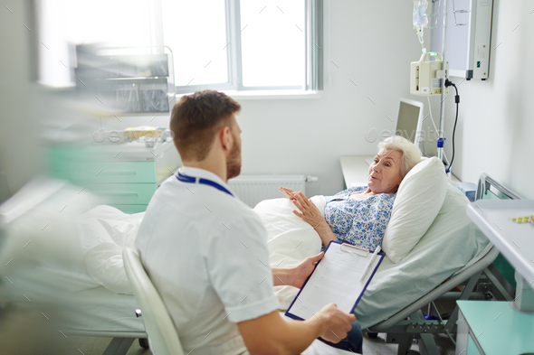 Female talking to doctor - Stock Photo - Images