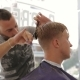 Barber Scissors Cuts The Hair Of The Client - VideoHive Item for Sale