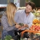 Couple Choose Vegetables At The Supermarket - VideoHive Item for Sale