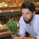 Man Smells Basil At The Supermarket - VideoHive Item for Sale