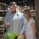 Couple Walk Through The Alcohol Section Of Hypermarket - VideoHive Item for Sale