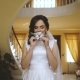 Dream Wedding. Beautiful Bride Waiting for the Groom with Boutonniere in her Hands - VideoHive Item for Sale