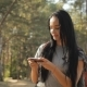 Female Hiker Uses Maps In Her Smartphone - VideoHive Item for Sale