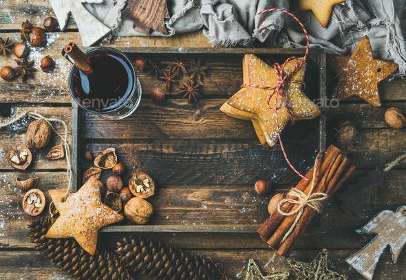 Glass of mulled wine, gingerbread cookies and spices, copy space - Stock Photo - Images