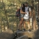 Hiking Couple Climbs On The Rock - VideoHive Item for Sale