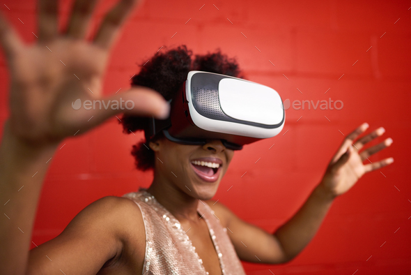 Cool millennial black woman exploring space with virtual reality - Stock Photo - Images