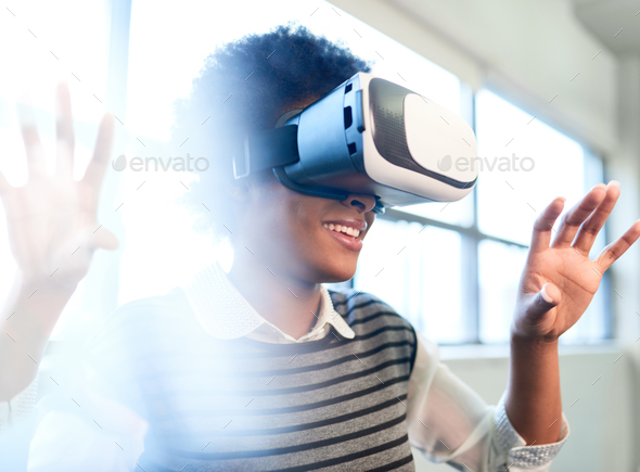 Cool millennial black woman exploring virtual reality glasses in - Stock Photo - Images