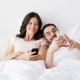 Happy Couple With Smartphones In Bed - VideoHive Item for Sale
