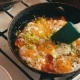 Cook Puts Ready Omelet Onto a Plate - VideoHive Item for Sale